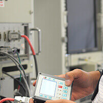 Engineers monitor electronic equipment